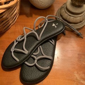 Black and white adjustable Sanuk sandals